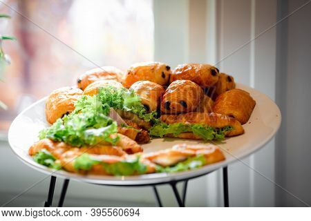 Chocolate Puff Pastry Buns On Restaurant Buffet Catering Table. Catering Buffet Table With A Delicio