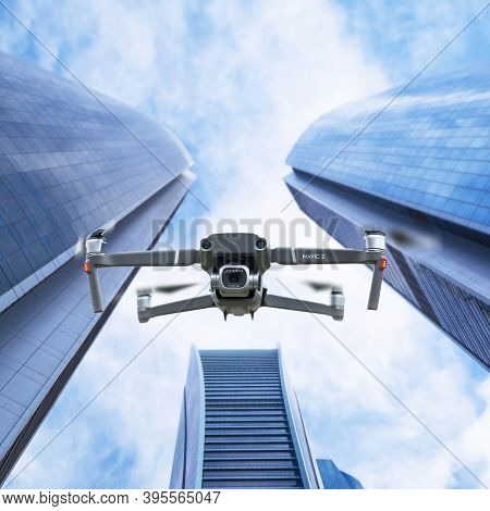 Gdansk, Poland - November 14, 2020: DJI Mavic 2 pro drone with hasselblad camera with skyscraper buildings background. Illustrative editorial content