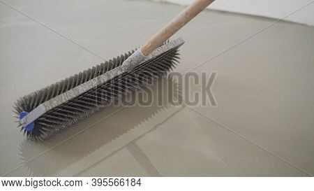 Charcoal Roller On The Self-leveling Floor. Charcoal Roller. Self-leveling Floor Tool. Self-leveling