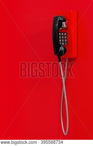 Red Wall Telephone (taxophone) On Red Background. Emergency Call To 112, 911,  Fire And Rescue, Medi