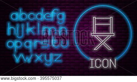 Glowing Neon Line Director Movie Chair Icon Isolated On Brick Wall Background. Film Industry. Neon L
