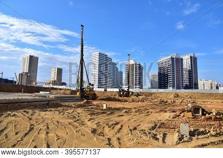 Construction Site With Machinery For Deep Foundation Piling. Vibrating Hydraulic Hammer. Hydraulical