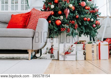 Boxes Decorated With Ribbons With Christmas Gifts Lie Under A Festive Christmas Tree With Christmas