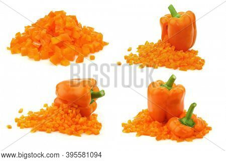 Fresh orange bell pepper (capsicum) with front side opened and already  cut pieces of paprika coming out  on a white background