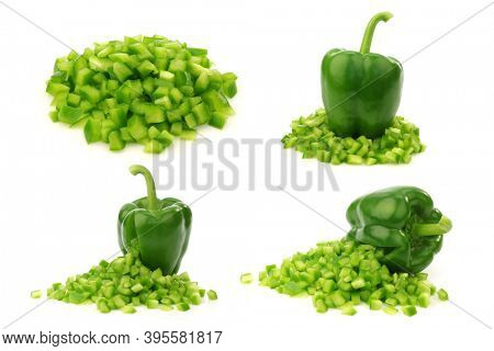 fresh green bell pepper (capsicum) with front side opened and already cut pieces of paprika coming out on a white background