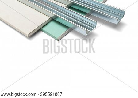 Basic elements for building a plaster wall, iron profile and plasterboard on white background