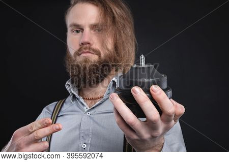 A Bearded Attractive Man Seller Of Auto Parts Shows And Holds An Internal Combustion Engine Pillow C