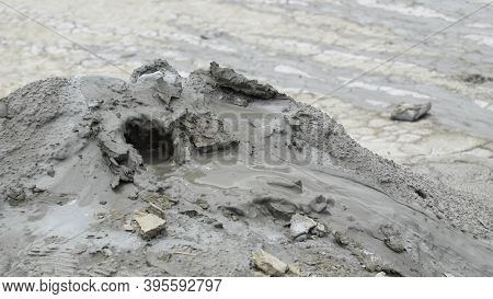 Mud Liquid Flowing From Mud Volcano, At Paclele Mari Mud Volcanoes In Buzau, Romania. Small Volcano-