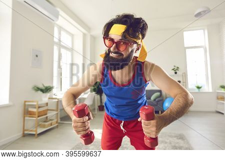 Funny Beginner Athlete Holding Dumbbells And Looking At Camera Motivating You To Exercise Too