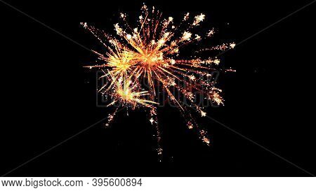 Fireworks Lights On A Black Background.festive Fireworks In The Night Sky.new Year Holiday Concept.