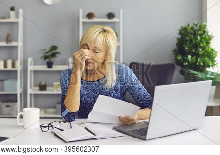 Tired Senior Woman Receiving Bankruptcy Notification Or Rejection Letter And Crying
