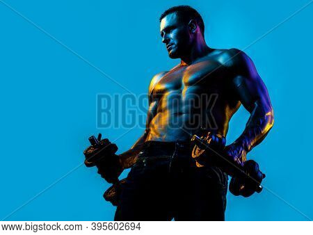 Sexy Muscular Body. Strong Fit Man Exercising With Dumbbells. Guy Lifting Weights. Naked, Nude Torso