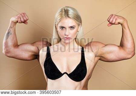 Woman Power. Girl With Drawn Hands Powerful. Young Fit Model. Strong And Confident Woman Flexing Her