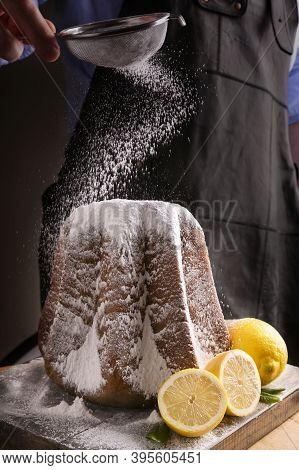 Man Pouring With Icing Sugar Soft Star-shaped Pasta. Traditional Italian Pastries From Verona For Ch