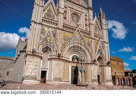 Orvieto, Italy - May 17, 2013. Facade View Of The Opulent And Monumental Orvieto Cathedral (duomo) W