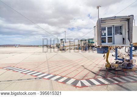 Fuerteventura, Spain - May 15, 2013. Empty Line Of Jet Bridges, Airbridge (passenger Boarding Bridge