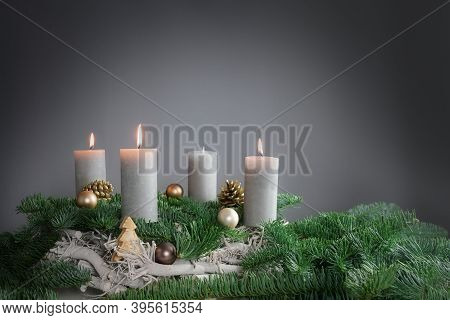 Three Of Four Candles Are Burning For The Third Advent On Fir Branches With Christmas Decoration Aga