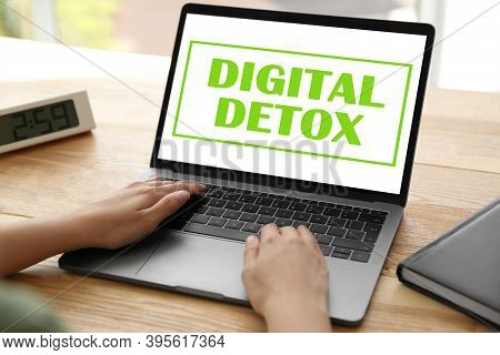 Woman Using Laptop With Text Digital Detox At Table, Closeup