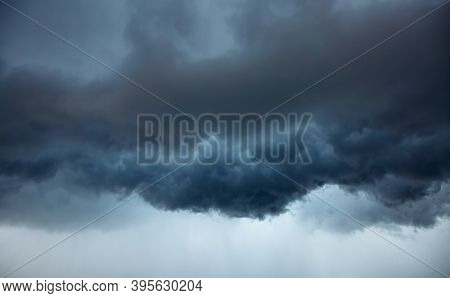 Tropical ominous clouds in front of the hurricane. Awesome photo of the texture of storm clouds. Adverse weather conditions. Climate change. Wallpaper force of nature. Discover the beauty of earth.