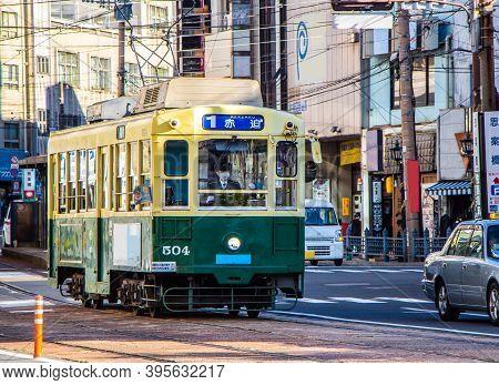 Nagasaki, Japan - 4 November 2020: Green And Yellow Tram In Nagasaki