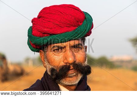 November 2019 Pushkar,rajasthan,india. Portrait Of Man With Red Turban,faces Of Rajasthan.