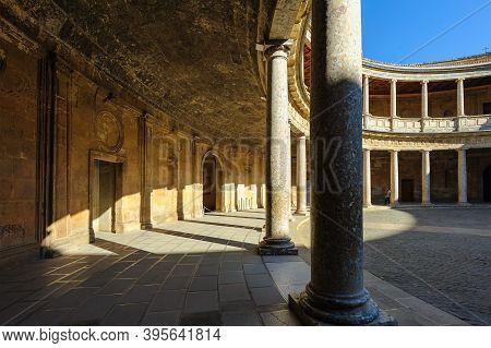Granada, Spain - January 7, 2020: View Of Enclosed Circular Courtyard At The Palace Of Charles V At