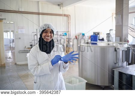 African black muslim business woman in local cheese production company