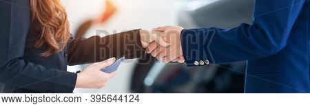 Auto Business Banner Background, Close Up Of Dealer Shaking Hands In Auto Show Or Salon, Concept Dea