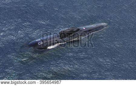 Military Naval Submarine On  Blue Sea Surface