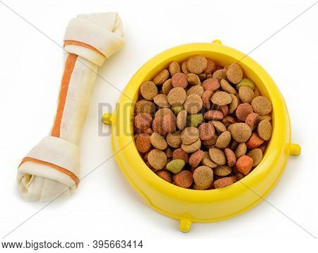 Bowl Of Kibbles And Bone. Crunchy Food Made Of Natural Ingredients