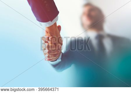 People shaking hands in business agreement
