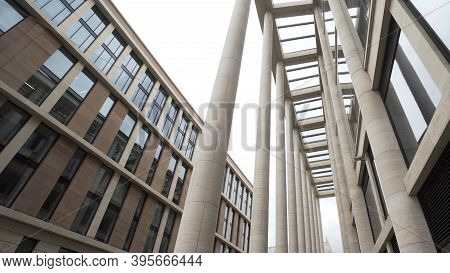 Facade Of A Building With Marble Columns. Action. Bottom View Of A Modern Architectural Complex, New