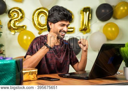 Concept Of Good News, Job Offer Or Luck During 2021 New Year Showing By Happy Excited Young Man In F