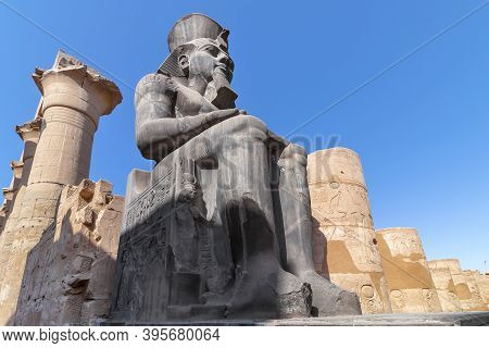 The Huge Statue Of Ramesses Ii In Luxor Temple, Egypt, A Large Ancient Egyptian Temple Complex Locat