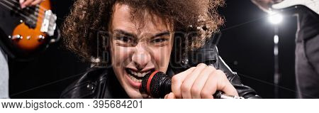 Kyiv, Ukraine - August 25, 2020: Angry Vocalist With Microphone Signing While Looking At Camera With