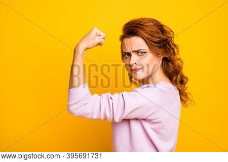 Profile Photo Of Confident Wavy Lady Raise Fist Up Showing Strong Biceps Muscle Pushing Hard Serious