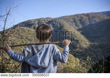 Child Boy Observing The Chorrero De La Virgen Waterfall At Natural Reserve Garganta De Los Infiernos