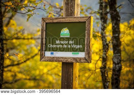 Caceres, Spain - Oct 31st, 2020: Wooden Sign At Natural Reserve Garganta De Los Infiernos. Chorrero