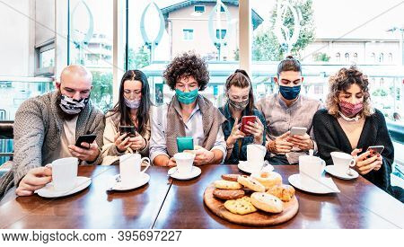 People Using Mobile Smart Phones At Coffee Bar Covered By Face Masks - New Normal Lifestyle Concept