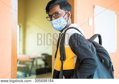College Stutdent With Face Mask Looking Into Camera Before Entering Classroom - Concept Of College R