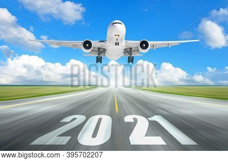 The Plane Flies Over The Runway With The Inscription 2021. The Concept Of Meeting The New Year