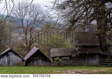 The Old Abandoned Wooden Houses In The Russian Village