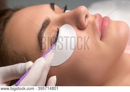 Woman With Long Lashes In A Beauty Salon. Eyelash Extension Procedure