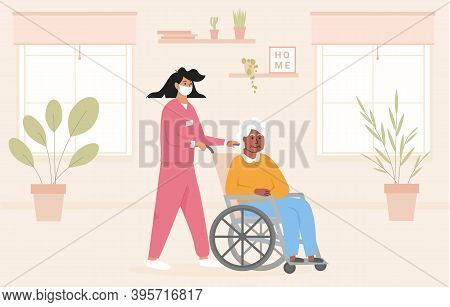 Concept For Old Age Home During Pandemic. Nurse Wearing Face Mask With Elderly Black Woman In Wheelc