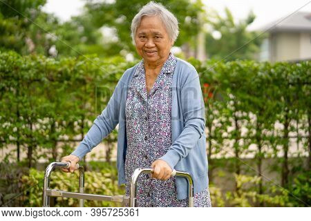 Asian Senior Or Elderly Old Lady Woman Patient Walk With Walker In Park : Healthy Strong Medical Con