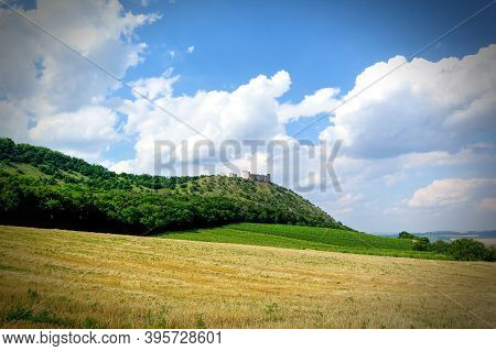 Castle In Palava, Czech Republic, Ruins Of Wall, Landscape Panorama Of Near Village.