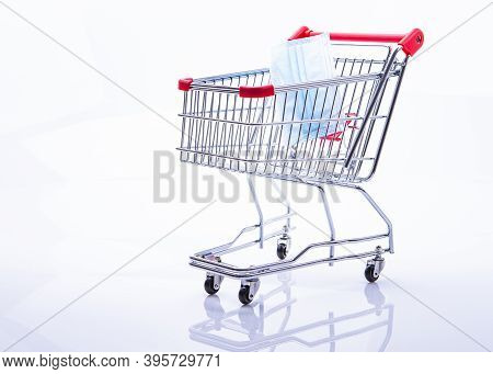 The Photo Shows A Shopping Cart With Protective Mask