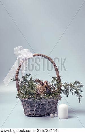 Basket With Coniferous Branches And Christmas Ball In Rustic Style. Christmas Decor Made Of Ecologic