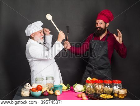 Chefs On Kitchen. Two Chefs Fighting On Kitchen. Kitchen. Cooking. Beared Chef Man. Delicious Food.