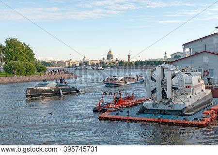 Saint-petersburg, Russia - August 16, 2020: People On The Yacht And Excursion Boats Travel Next To T